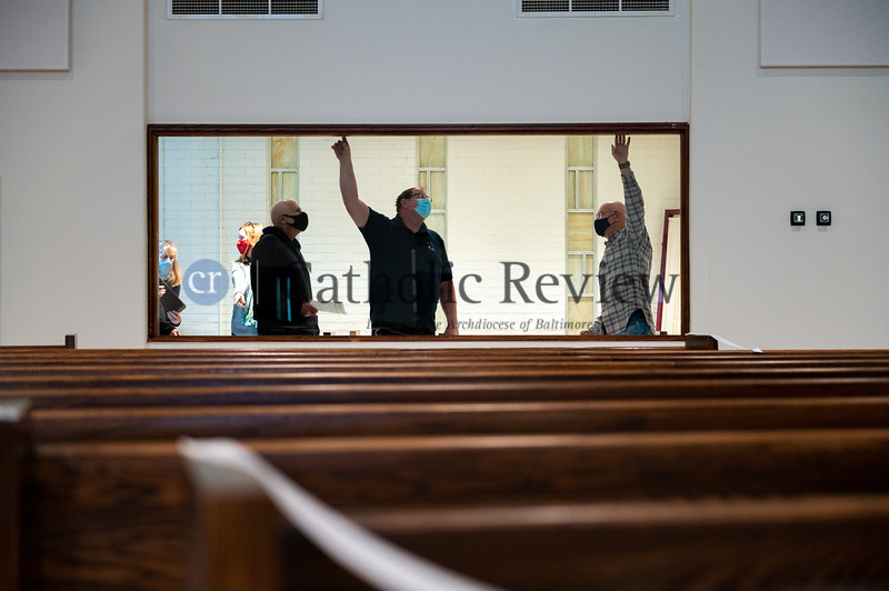 Representatives from St. Philip Neri Church in Linthicum Heights do a walk through with contractors Jan 5 following a six month, $1.5 million renovation. (Kevin J. Parks/CR Staff)