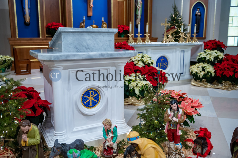 The new altar, ambo and baptismal font at St. Philip Neri Church in Linthicum Heights were hand crafted from wood by artisans in Lima, Peru, which was initiated through a relationship with missionaries from the region currently staying at the parish. (Kevin J. Parks/CR Staff)