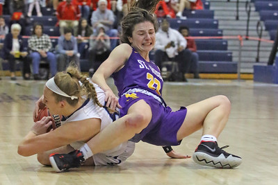 Brynn Farrell (right) gets tangled up with an Immaculate Heart defender  as St. Rose High School takes Immaculate Heart Academy during the NJSIAA Non Public Group A girls basketball championship held at the RWJ Barnabas Arena in Toms River on Saturday March 9, 2019. (MARK R. SULLIVAN /THE COAST STAR)