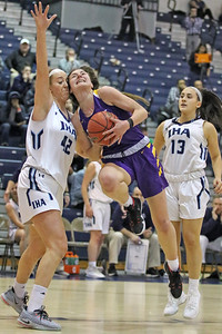 Brynn Farrell (center) gets past the Immaculate Heart defense  as St. Rose High School takes Immaculate Heart Academy during the NJSIAA Non Public Group A girls basketball championship held at the RWJ Barnabas Arena in Toms River on Saturday March 9, 2019. (MARK R. SULLIVAN /THE COAST STAR)