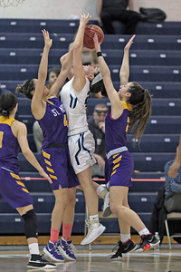 Samantha Mikos (left) and Brynn Ferrell (right) combine for the stop of Emma Matesic (center) attempt at a basket as St. Rose High School takes Immaculate Heart Academy during the NJSIAA Non Public Group A girls basketball championship held at the RWJ Barnabas Arena in Toms River on Saturday March 9, 2019. (MARK R. SULLIVAN /THE COAST STAR)