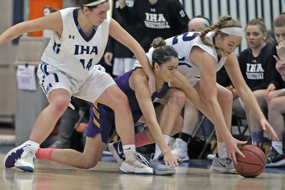 Samantha Mikos (center) battles with two defenders for a loose ball as St. Rose High School takes Immaculate Heart Academy during the NJSIAA Non Public Group A girls basketball championship held at the RWJ Barnabas Arena in Toms River on Saturday March 9, 2019. (MARK R. SULLIVAN /THE COAST STAR)
