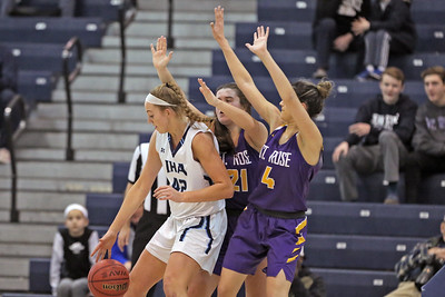 Anna Morris (left) is surrounded by Maggie Stapleton (center) and Samatha Mikos as St. Rose High School takes Immaculate Heart Academy during the NJSIAA Non Public Group A girls basketball championship held at the RWJ Barnabas Arena in Toms River on Saturday March 9, 2019. (MARK R. SULLIVAN /THE COAST STAR)