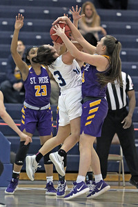 Brittany Graff (center) has her shot attempt blocked by Maureen Stapleton (right) as St. Rose High School takes Immaculate Heart Academy during the NJSIAA Non Public Group A girls basketball championship held at the RWJ Barnabas Arena in Toms River on Saturday March 9, 2019. (MARK R. SULLIVAN /THE COAST STAR)