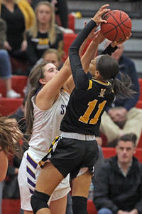 Maggie Stapleton (left) blocks the shot attempt of Rahmena Henderson as St. Rose High School takes on St. John Vianney High School during the NJAISS South Jersey, Non-Public A girls basketball championship held at Jackson Liberty High School  on Tuesday March 5, 2019. (MARK R. SULLIVAN /THE COAST STAR)