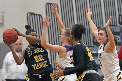 Lauren Lithgow (center) and Mary Donnelly (right) corral Madison St. Rose (left) as  St. Rose High School takes on St. John Vianney High School during the NJAISS South Jersey, Non-Public A girls basketball championship held at Jackson Liberty High School  on Tuesday March 5, 2019. (MARK R. SULLIVAN /THE COAST STAR)