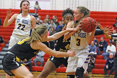 Lauren Lithgow (right) battles with St John Vianney defenders as St. Rose High School takes on St. John Vianney High School during the NJAISS South Jersey, Non-Public A girls basketball championship held at Jackson Liberty High School  on Tuesday March 5, 2019. (MARK R. SULLIVAN /THE COAST STAR)