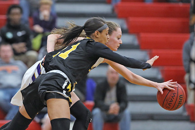 Lauren Lithgow (left) battles with Rahmena Henderson for control of a loose ball as St. Rose High School takes on St. John Vianney High School during the NJAISS South Jersey, Non-Public A girls basketball championship held at Jackson Liberty High School  on Tuesday March 5, 2019. (MARK R. SULLIVAN /THE COAST STAR)