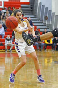 Samantha Mikos watches as the ball she just passed is kicked out of bounds as St. Rose High School takes on St. John Vianney High School during the NJAISS South Jersey, Non-Public A girls basketball championship held at Jackson Liberty High School  on Tuesday March 5, 2019. (MARK R. SULLIVAN /THE COAST STAR)