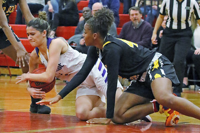 Samantha Mikos (left) dives to grab a loose ball as  St. Rose High School takes on St. John Vianney High School during the NJAISS South Jersey, Non-Public A girls basketball championship held at Jackson Liberty High School  on Tuesday March 5, 2019. (MARK R. SULLIVAN /THE COAST STAR)