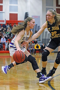 Lauren Lithgow (left) battles past St. John Vianney's Katie Hill (right) as St. Rose High School takes on St. John Vianney High School during the NJAISS South Jersey, Non-Public A girls basketball championship held at Jackson Liberty High School  on Tuesday March 5, 2019. (MARK R. SULLIVAN /THE COAST STAR)