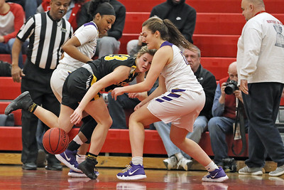 Makalyla Andrews (left) and Mary Donnelly (right) battle for a loose ball with Sarah Karpell of St John VIanney as St. Rose High School takes on St. John Vianney High School during the NJAISS South Jersey, Non-Public A girls basketball championship held at Jackson Liberty High School  on Tuesday March 5, 2019. (MARK R. SULLIVAN /THE COAST STAR)