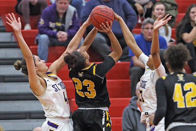 Samantha Mikos (left) and Makayla Andrews (right) combine to stop Sajada Bonner (center) from making the shot as St. Rose High School takes on St. John Vianney High School during the NJAISS South Jersey, Non-Public A girls basketball championship held at Jackson Liberty High School  on Tuesday March 5, 2019. (MARK R. SULLIVAN /THE COAST STAR)