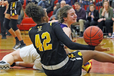 Brynn Farrell battles with Brelynn Bellamy for a loose ball as St. John Vianney defenders for the bucket as St. Rose High School takes on St. John Vianney High School during the NJAISS South Jersey, Non-Public A girls basketball championship held at Jackson Liberty High School  on Tuesday March 5, 2019. (MARK R. SULLIVAN /THE COAST STAR)