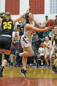 Brynn Farrell battles past St. John Vianney defenders for the bucket as St. Rose High School takes on St. John Vianney High School during the NJAISS South Jersey, Non-Public A girls basketball championship held at Jackson Liberty High School  on Tuesday March 5, 2019. (MARK R. SULLIVAN /THE COAST STAR)