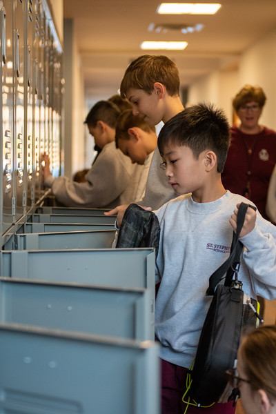 St. Stephen School sixth-graders Francis de Lara and Zachary Gaudino place their belongings in new lockers Jan 2, as the Bradshaw school moved into a new addition for grades six through eight to start the 2020 calendar year. (Kevin J. Parks/CR Staff)