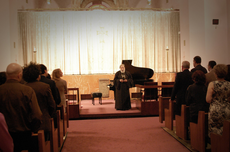 Archbishop Yeghishe Gizirian delivers the benediction at the conclusion of the concert program.