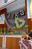 School hall decorated with flowers and yellow and blue symbols.<br /> Шкільна зала прикрашена квітами та жовто-блакитними символами.
