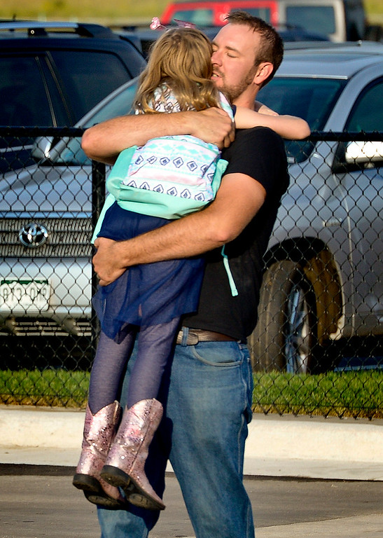 . Best ERIE, CO - AUG. 15: TJ Rose embraces his third grade daughter Alyce Rose while dropping her off for the first day of school at Soaring Heights PK-8, 3280 County Road 5, Wednesday morning, Aug. 15, 2018. The new school has about 960 students enrolled. To view more photos visit timescall.com. (Photo by Lewis Geyer/Staff Photographer)