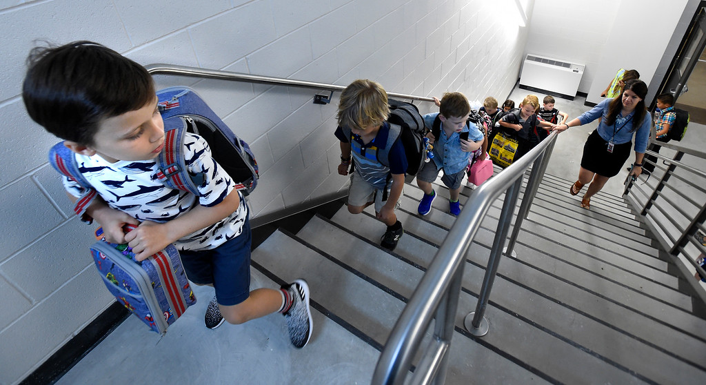 . BROOMFIELD, CO: August 15:  First graders go up the stairs to Ms Alissa Alegre\'s class during the first day of school at Thunder Vista P-8 in Broomfield on August 15, 2018. (Photo by Cliff Grassmick/Staff Photographer).