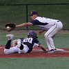Lynn, Ma. 5-23-17. The ball doesn't quite get to Anthony Nickolakakis at first base in time as Dan Frey of St. John's arrives first.