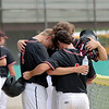 North Clay players Logan Fleener (2), Collyn Ballard (4), and Holden Clifton (18) embrace before a baseball game against Effingham (St. Anthony) in the Class 1A Sectional 6 Regional Finals on Monday, July 7, 2021, at Evergreen Hollow Park, in Effingham, Illinois. (Alex Wallner/Effingham Daily News)