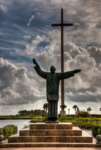 cross-statue-clouds