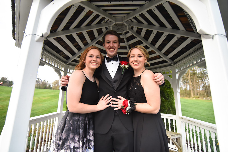 St. Bernards junior Lissa Hoyt (left) junior Nicholas Dee (center) and junior at Lunenburg High School Kayla Rhoades pose for a photo outside the Sterling National Country Club on Saturday for the St. Bernards junior/senior prom.  SENTINEL & ENTERPRISE JEFF PORTER