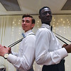 St. Bernards seniors Nick Bagley (left) and Nathan Agyeman pull their suspends at the Sterling National Country Club on Saturday for the St. Bernards junior/senior prom.  SENTINEL & ENTERPRISE JEFF PORTER