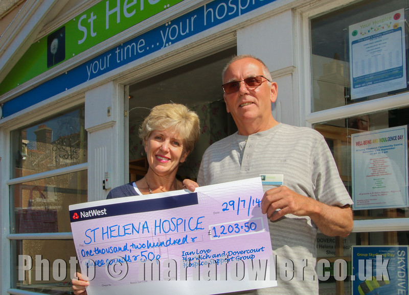Catherine Venables (St Helena Hospice Community Fundraising Manager) and Ian Love (Harwich and Dovercourt Hospice Support Group)Cheque presentation from Ian Love of the newly formed Harwich and Dovercourt Hospice Support Group, for £1203.50 raised at a Hog Roast in aid of St Helena Hospice on Sunday 20th July 2014.For further information please call Ian Love on 01255 507365 or Mob. 07786-060474or Catherine Venables St Helena Hospice Community Fundraising Manager Tel: 01206 890168 Mob 07795-334524PHOTO Copyright © Maria Fowler 2014 Ref: 20140729-IMG_3190