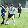 Jake Butler takes the ball away from a Putnam player