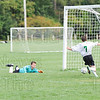 After the ball ticked off the goalie's glove Brady Collins swoops in to make  a clear and prevent a sure goal
