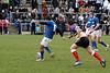 Shaun McCarthy striking another kick. Hugh Hogan looks on