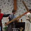 Station 5. Simon of Cyrene helps Jesus carry his cross.