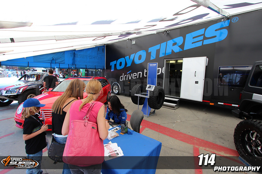 Fans visit the Toyo Tires display at Round 3 of Stadium Super Trucks at Los Angeles Memorial Coliseum in Los Angeles, California on April 27, 2013.Chris Anderson/114photography