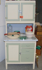 Kitchen stand-alone storage cabinets, and kitchen accesories, are very popular right now. In the antiques world, these items are relatively new, because the function of a kitchen changed substantially over the past century. (E. Elliott photo)