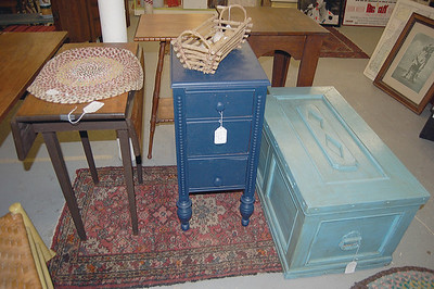 This blue painted end table is actually one side section of a dressing table. It is priced right at $25. (E. Elliott photo)