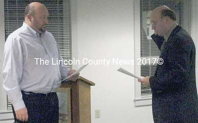 Former Maine state Senator and teacher Dana Dow (right) swears in to his new position as a member on the MSAD 40 School Board Tuesday, Jan. 13.