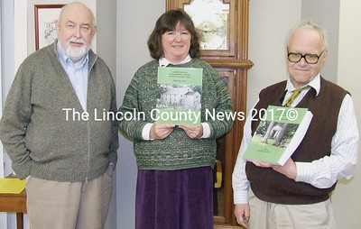 "Waldoboro geneologist Randall Gross (right) donated his two-volume set ""Cemetaries of Waldoboro, Maine and Surrounding Areas,"" representing much of his work, to the Waldoboro Public Library. Accepting the donation is Waldoboro Public Library Director Sara Gallant, accompanied by Tom Jordon of the Waldoborough Historical Society. (photo courtesy Waldoboro Public Library)"