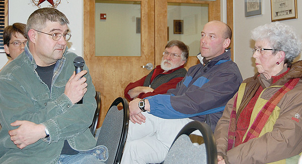 Damariscotta Police Chief Steve Drake, Dean, and Jo-Ann (Waltz) Jacobs, of Waltz Pharmacy, discuss the pros and cons of  moving the Concord Trailways bus stop off Main Street. (E. Elliott photo)