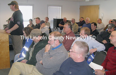 Waldoboro firefighter Roy Hatch addressed selectmen in support of former Fire Chief Ernest Vannah during a special meeting on Sat., Jan. 24. Roughly 50 firefighters, emergency personnel and citizens turned out at the meeting over the resignation of Chief Vannah (low right). (J Maguire photo)