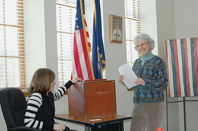 Deborah Schling casts her ballot in the Alternative Organization Structure plan vote at the Damariscotta Town Office Jan. 27. By 1 p.m., less than 20 people had cast their vote in Damariscotta. (E. Elliott photo)
