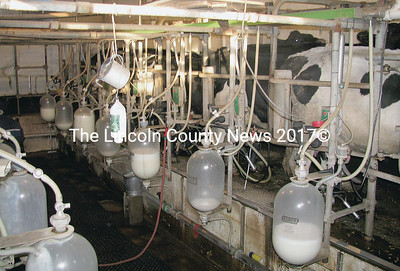 Dairy producers may be forced to make some tough decisions if prices for their milk fall below the cost of production. Dairy farmer Russell Anderson said he would consider other options such as selling raw milk acquired via his pumping room pictured here. (J Maguire photo)