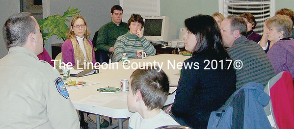 Lt. Rand Maker of the Lincoln County Sheriff's Office meets with members of Youth Promise, including, at end of table, his son, Jacob,  Sue Benner (hidden behind Lt. Maker), Janine Garceau, and Lee Emmons (back left). (photo provided by Joyce Steel)