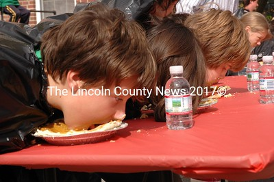 Slurp. No hands, please. Punkin'pie eating, Damariscotta style. (Joe Gelarden photo)