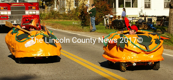 Pumpkin cars are on the road at the Pumpkinfest parade. (photo Steve Edwards)