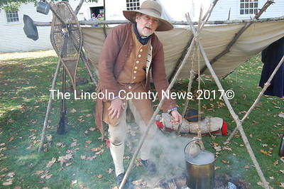 Making peas porridge hot keeps Paul Daiute of Hallowell busy Saturday as an interpretive historian during a fundraiser Saturday for Lincoln County Historical Association. (Greg Foster photo)
