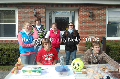 Wiscasset High School sophomores have fun selling baked goods to raise money for their class. Rear, from left, Ayla McDorr, Connor Huggins, Carolyn Footer, and Abby Foster. Front, from left, Ben Sutter and Morgan Suydam. (Greg Foster photo)