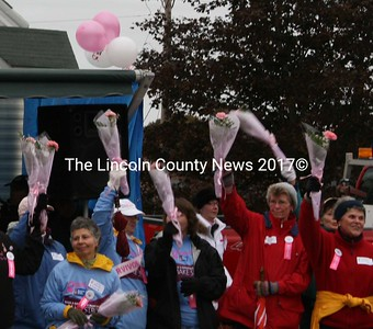 Breast Cancer survivors came together during the annual Making Strides Against Breast Cancer walk in Damariscotta on Sunday, inspiring the several hundred people in town to do their part to raise money for research. (J Maguire photo)