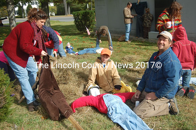 Creating a scarecrow makes a fun day in Wiscasset on Saturday as an event sponsored by Wiscasset Community Center for the second year in a row. From left, Donna Brewer, Zachary Brewer, Josh Brewer, and Emma Brewer. (Greg Foster photo)